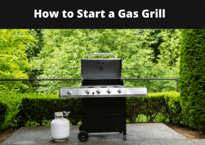 black gas grill with white propane cylinder and lush green bakcground of plants and shrubs